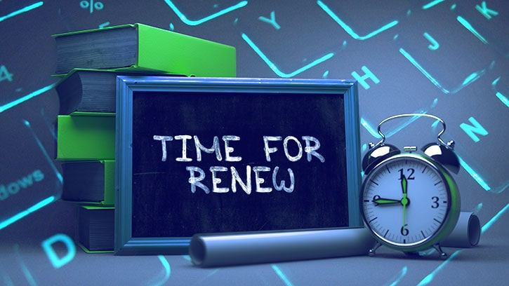 """Books and alarmclock next to a chalkboard that says """"Time for renew"""" for hosting"""