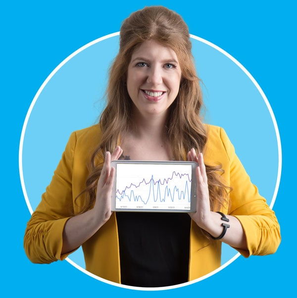 Alison Knott holding up tablet that shows an organic SEO chart with growth