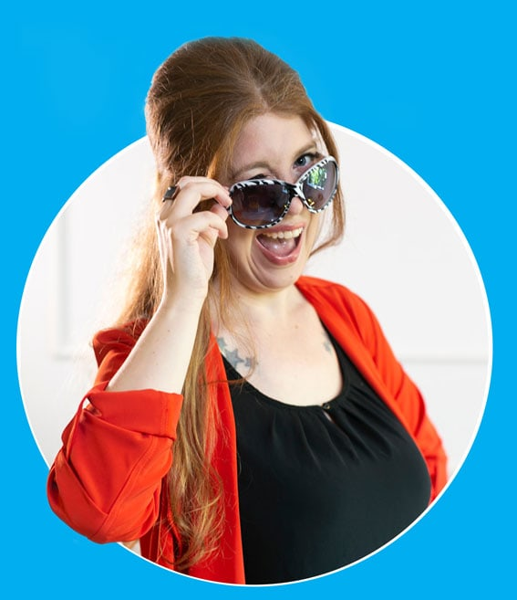 Web Consultant Alison K wearing fancy sunglasses with them slightly pulled down in cheeky wink and smile. She is in a cutout circle.